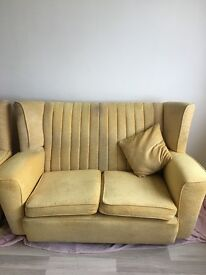 ELEGANTLY SHAPED WING BACK TWO SEATER SOFA AND TWO ARM CHAIRS.