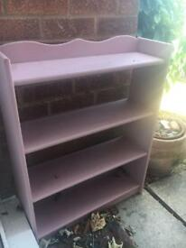 Dusty pink book shelf unit