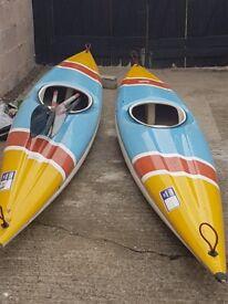 Two matching fibreglass kayaks