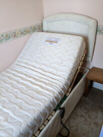 Electric adjustable bed in excellent working order.