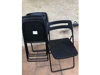 4 Black folding chairs