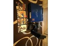 PlayStation 2 + 4 Games