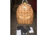 Authentic mcm small backpack in cognac