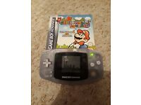 Clear Nintendo Gameboy Advance Console with Boxed Mario bros and Super Mario Bros 2