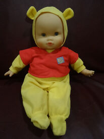 Beautiful doll in Winnie the Pooh outfit and with tiny Winnie
