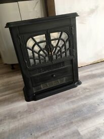 Black electric heater with gorgeous wood fire surround and cream marble hearth and backing