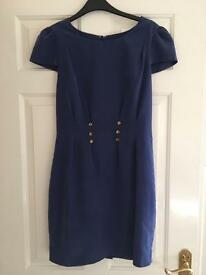 Navy party dress with gold buttons