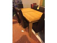 showroom condition,never used-solid OAK dining table and six leather chairs