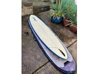 "7'6"" surf board and case"