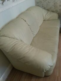 Cream three seater comfortuable leather sofa