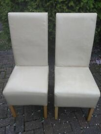 Two cream leather look chairs