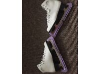 Lake placid ice skatesused for lessons good condition. Size 8 white with purple caps on the skates.