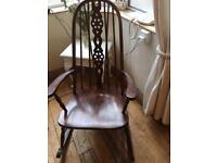 A SUPER VINTAGE ROUND TOPPED ROCKING CHAIR WITH CARTWHEEL DESIGN TO THE BACK