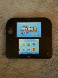 Nintendo 2DS with Super Mario Bros. 2 and charger.