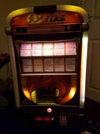 Wall mounted jukebox