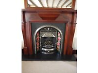 Perfect fire surround and ornate insert with marble hearth.