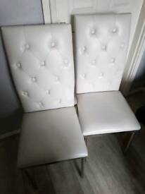 2x white leather dining chairs