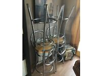 Four chrome and wooden bar stools