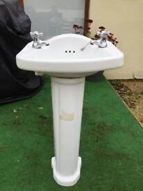 White sink with pedestal