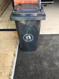 Black rubbish/ waste wheelie bin