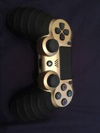 Gold PS4 controller with grips