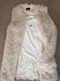 Cream leotard top and cream faux fur waistcoat