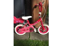 Childs bike with teddy seat