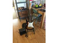 Crafter 'Cruiser' electric guitar with stand, padded bag, amp and leads etc