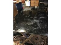 A good condition black dining table for sale the size is 135cm by 80 cm