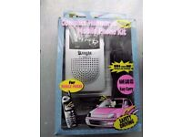Compact Handsfree Mobile Phone Kit - Portable - take with you or install in car - takes 2 x AAA batt