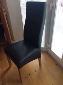 Two high back leather look brown dining chairs. £30 no marks - in good condition