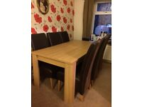 Large Dining table and Six Leather chairs