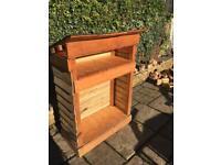Wood log storer