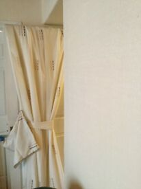 Two pairs of lightweight voile curtains, lined and 5 cushion covers. In immaculate condition.