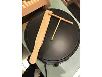 Crepe maker with wooden scraper and spreader