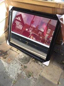huge black swept framed mirror