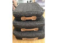 Black wicker storage baskets with lids, brown faux leather with silver studs details