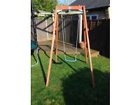 plum single wooden swing set great condition