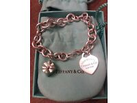 Tiffany bracelet with heart and present charms