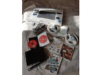 Nintendo Wii Console and Wii Fit Board plus some games and wheels