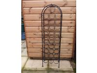 Black metal wine rack - holds 28 bottles