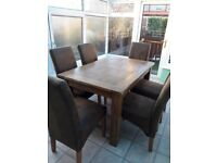 Oak dining table and 6 faux leather chairs.good condition.£220.