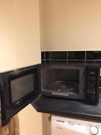 Black Kenwood Solo Microwave cooker