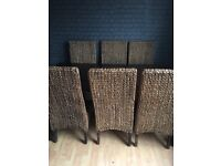 Beautiful dark solid wood dining room and 6 wicker chairs