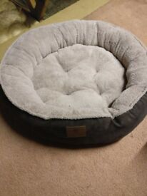 A plush and cozy dog bed - NEW