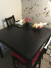 Dining room Table..Black... does pull out to make table larger.. with 4 chairs