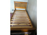 Good, solid wood single bed, matress included if wanted.