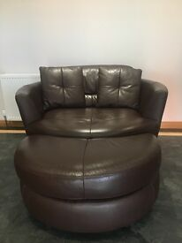brown leather chair with foot stool.