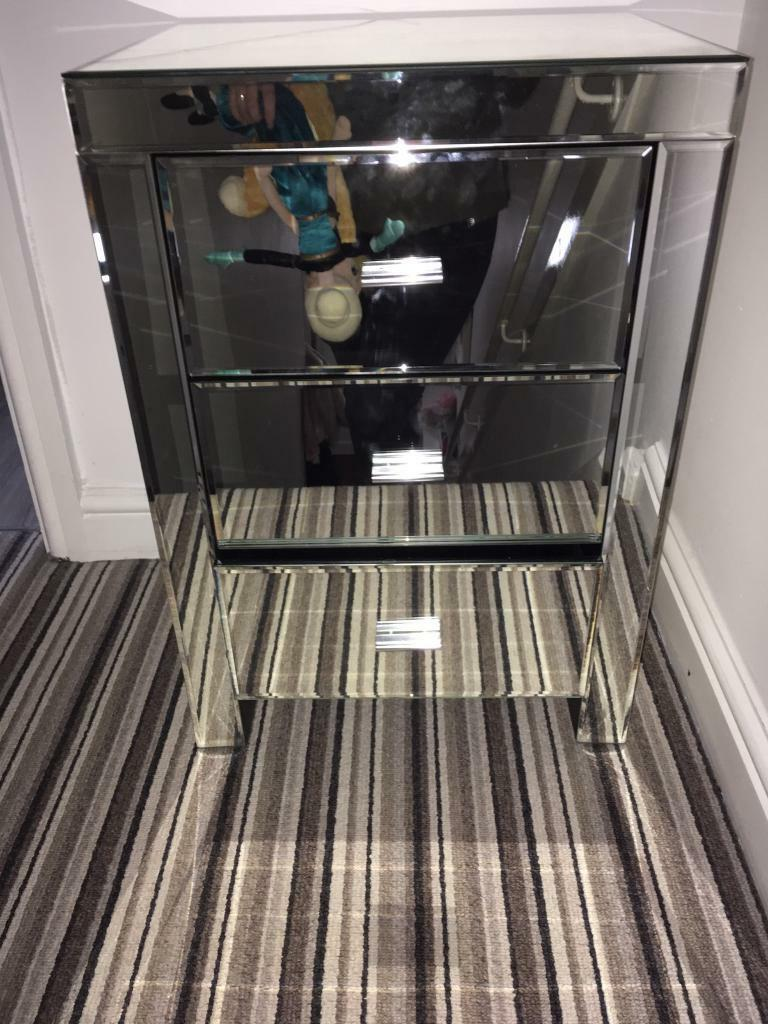 Mirrored bedside table with crack