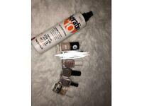 Set of nail polishes and a professional heat protecting hair spray
